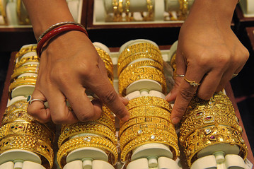 In India, Gold-Related Shares Melt Down