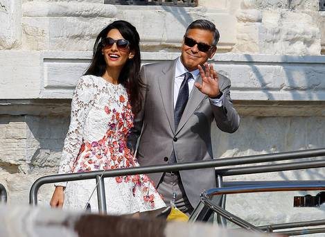 It's Mr and Mrs Clooney (and they have the bands to prove it)