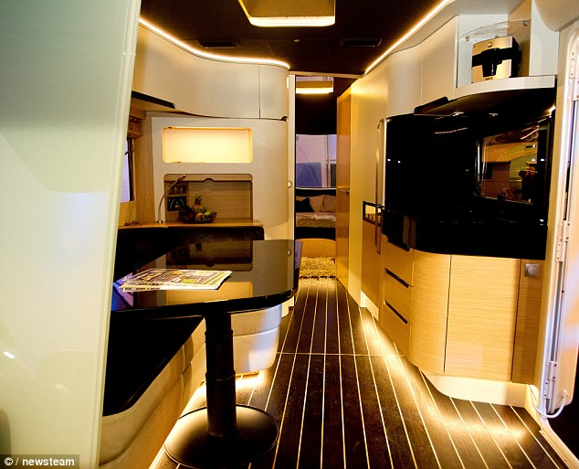 Caravisio caravan features cinema, touch screen shower and iPad-controlled …
