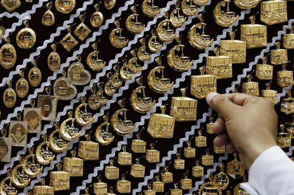Gold dips from six-week peak as dollar firms, physical demand eases