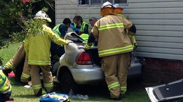 Woman trapped after car runs into Gold Coast house